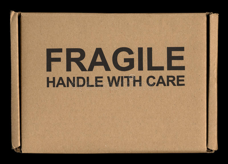 Fragile handle with care label tag. Fragile handle with care warning sign label tag on a cardboard box stock images
