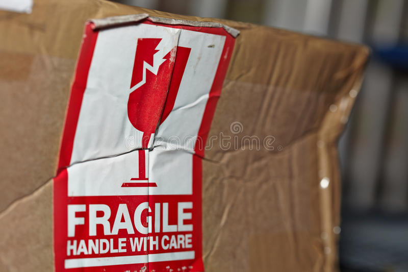 Fragile Handle With Care Sign. On A Damaged Package royalty free stock photography