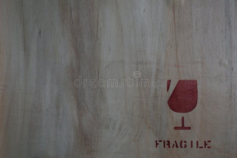 Fragile icon on wood board stock image