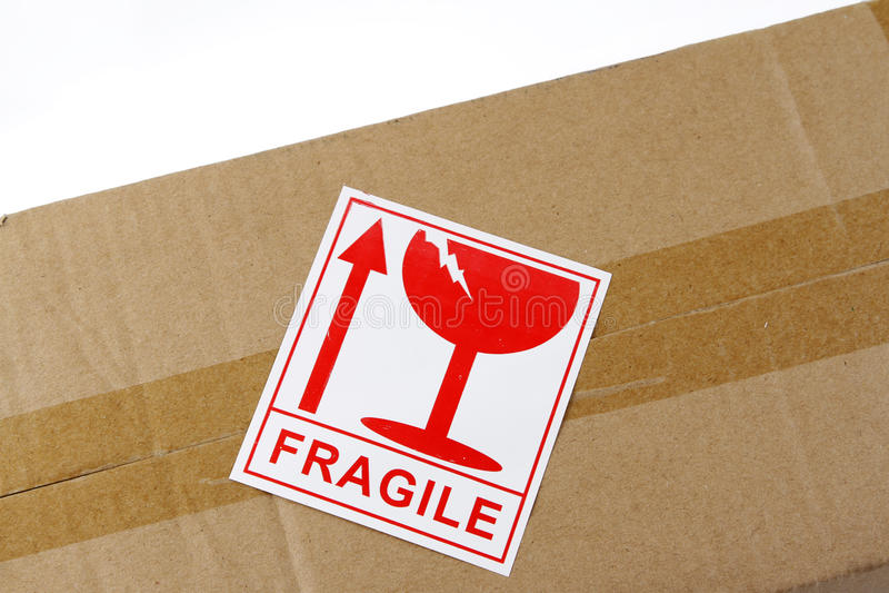 Fragile label. On top of cardboard box stock photos