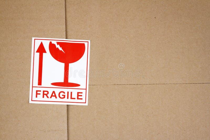 Fragile. Label on cardboard box stock photo