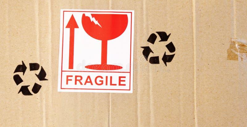 Fragile. Label on cardboard box stock image