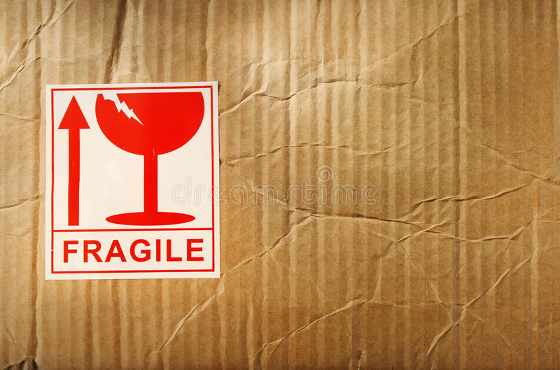 Fragile. Label on cardboard box royalty free stock images
