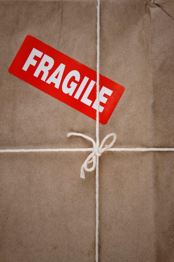 Fragile. Label on cardboard box stock photos