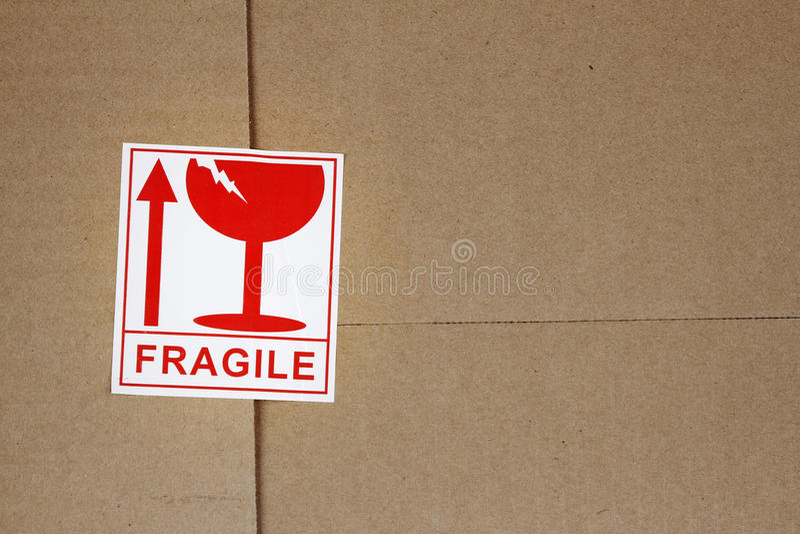 Fragile. Label on cardboard box stock photography