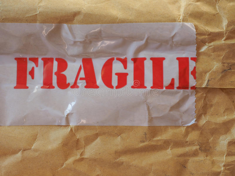 Fragile label on packet. Fragile label on a small packet or parcel royalty free stock photos