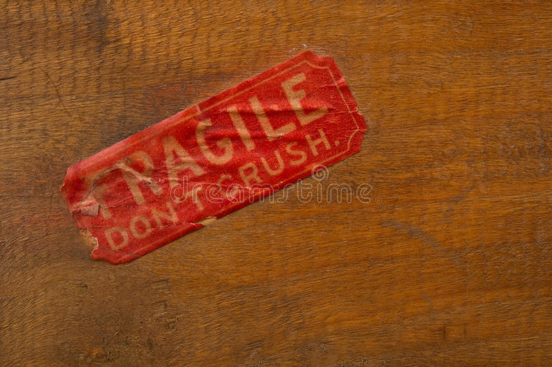 Fragile Label on Wood. Image of an antiqued fragile label on wood background royalty free stock photos