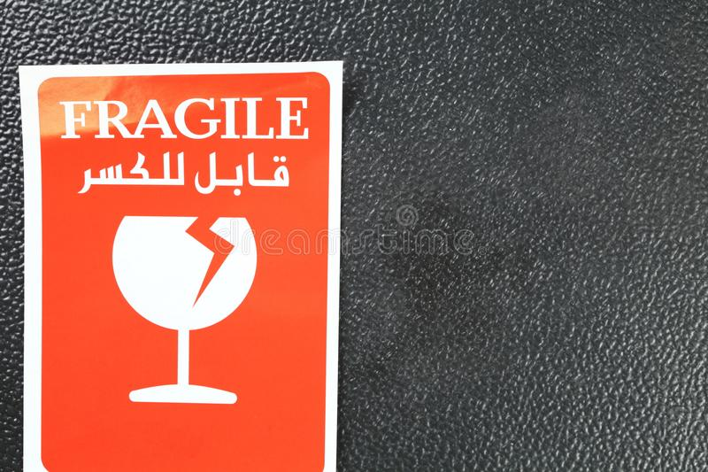 Fragile sticker scene. The fragile paper sticker label represent the logistic business and symbol concept related idea royalty free stock images