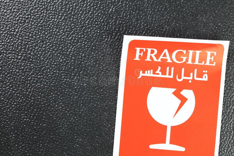 Fragile sticker scene. The fragile paper sticker label represent the logistic business and symbol concept related idea stock photography