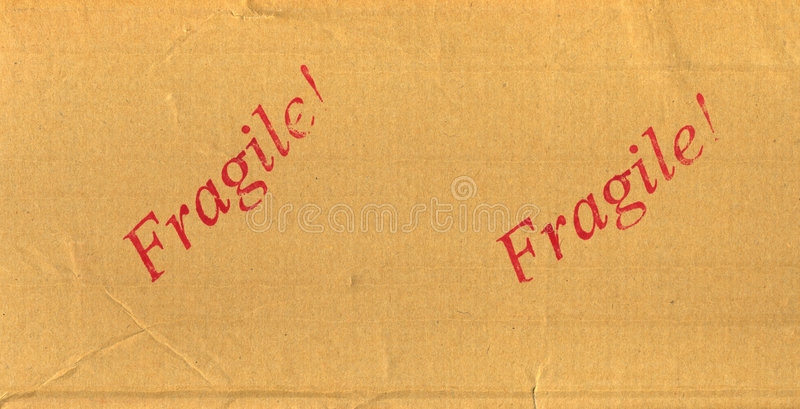 Fragile rouge estampé sur le module de courrier photo stock