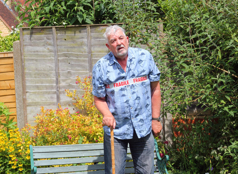 Fragile senior man walking with cane. royalty free stock images