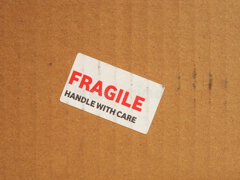 Fragile sign. Fragile warning sign label tag on a cardboard box royalty free stock photography