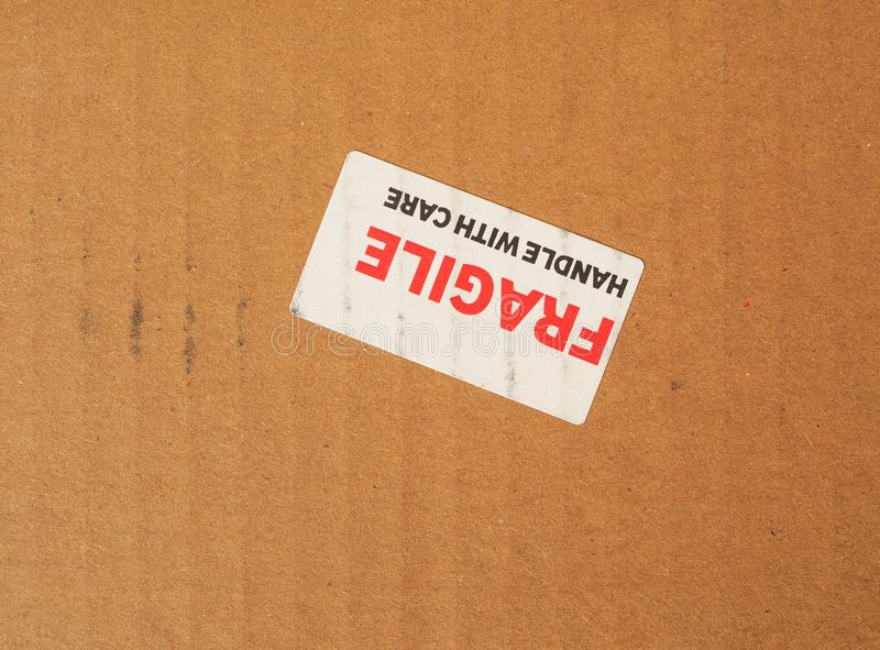 Fragile sign. Fragile warning sign label tag on a cardboard box royalty free stock photos