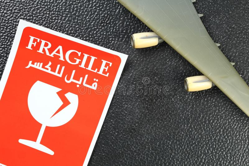 Fragile sticker scene. The fragile paper sticker label represent the logistic business and symbol concept related idea stock images