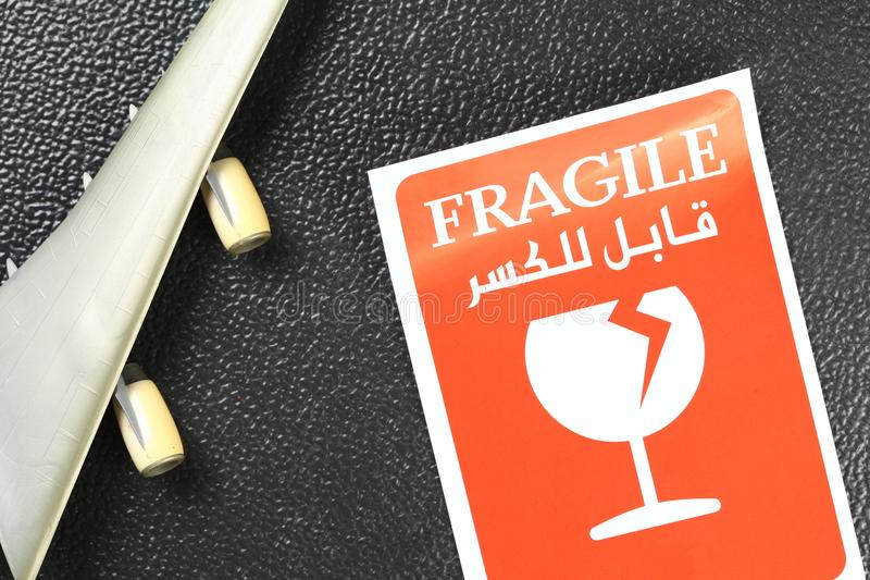 Fragile sticker scene. The fragile paper sticker label represent the logistic business and symbol concept related idea royalty free stock image