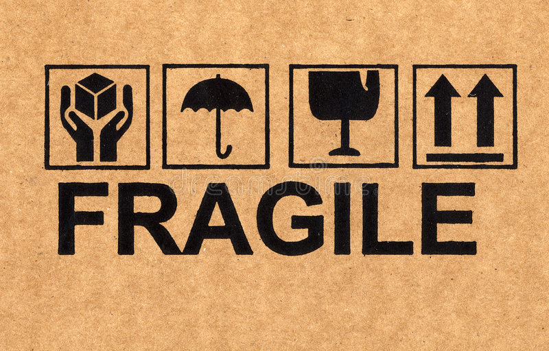 Fragile symbol on cardboard royalty free stock photos