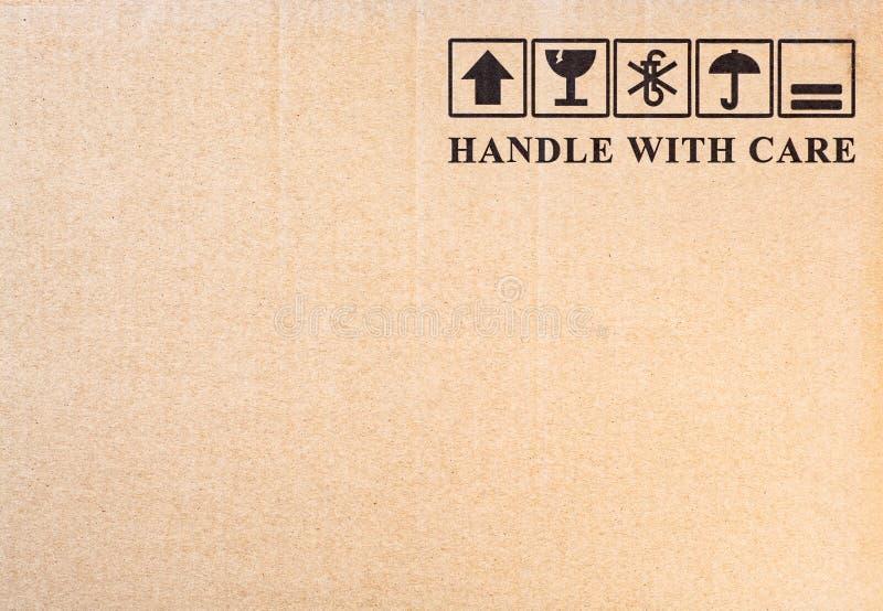 Fragile symbol on cardboard background. stock photo