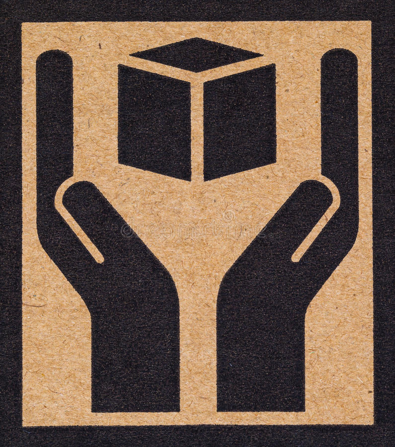 Fragile symbol on cardboard. stock photography