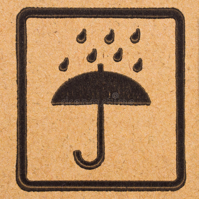 Fragile symbols on cardboard. Image close-up of grunge black fragile symbols on cardboard royalty free stock image