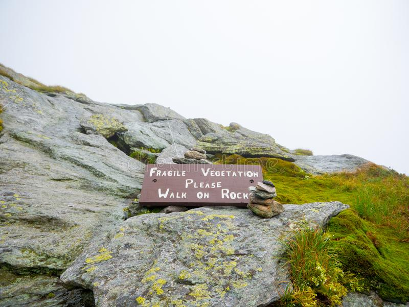 `Fragile vegetation`Sign. Can be killed by footsteps. Please stay on trails. Camels Hump mountain in Vermont.  stock image