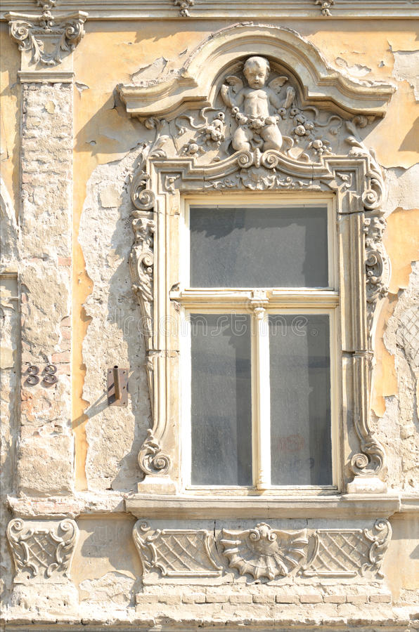 Fragment of ancient building with moulding royalty free stock photo