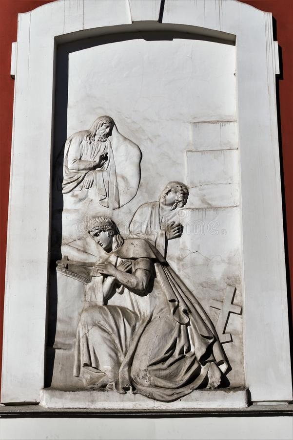 Fragment of an ancient religious bas-relief on the wall of the church of St. Panteleimon in St. Petersburg, Russia. A religious biblical scene adorns the wall royalty free stock image