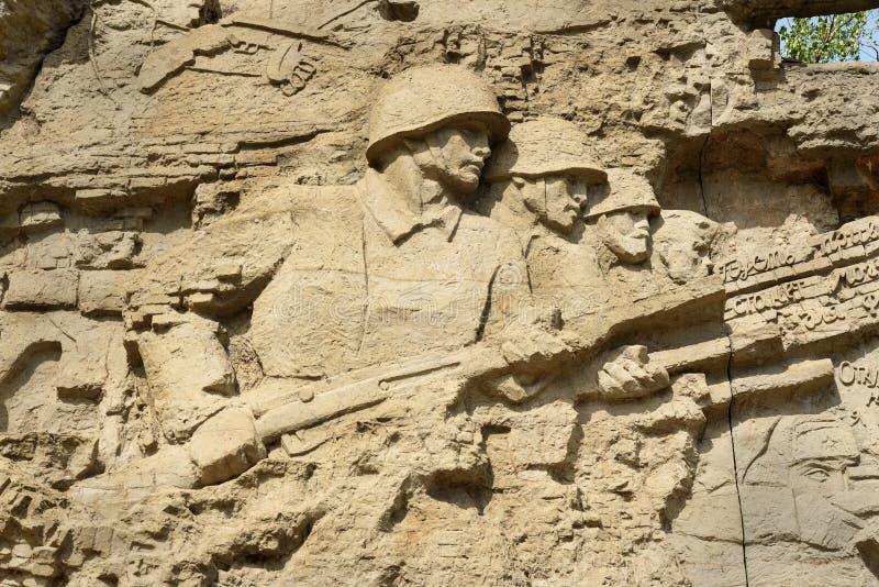 Fragment av basrelief av förstörda väggar Minnes- komplexa Mamayev Kurgan i Volgograd arkivfoto