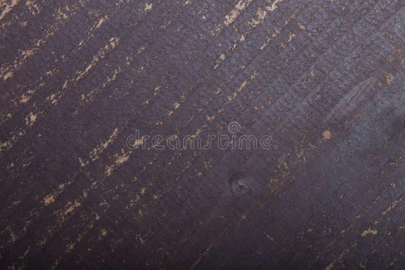 Fragment av den gamla målade trädörren tonat royaltyfri foto
