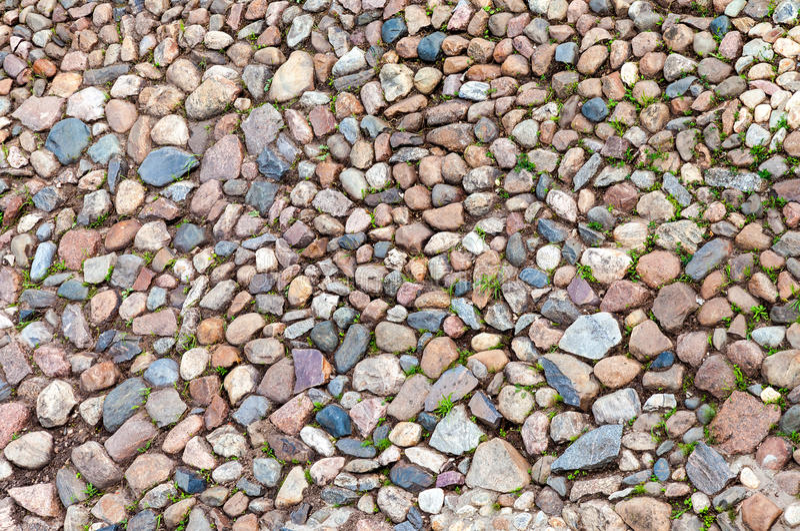 Fragment av den gamla naturliga stenväggen royaltyfria foton