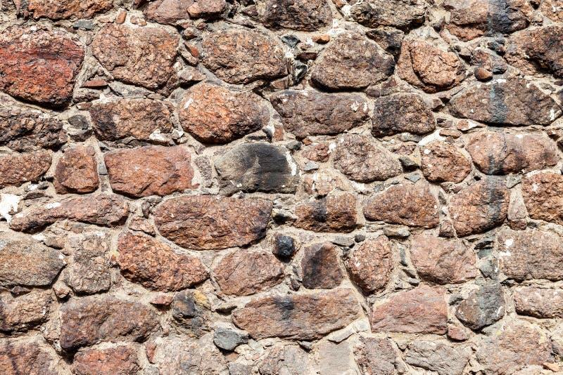 Fragment av den gamla stenväggen arkivbild