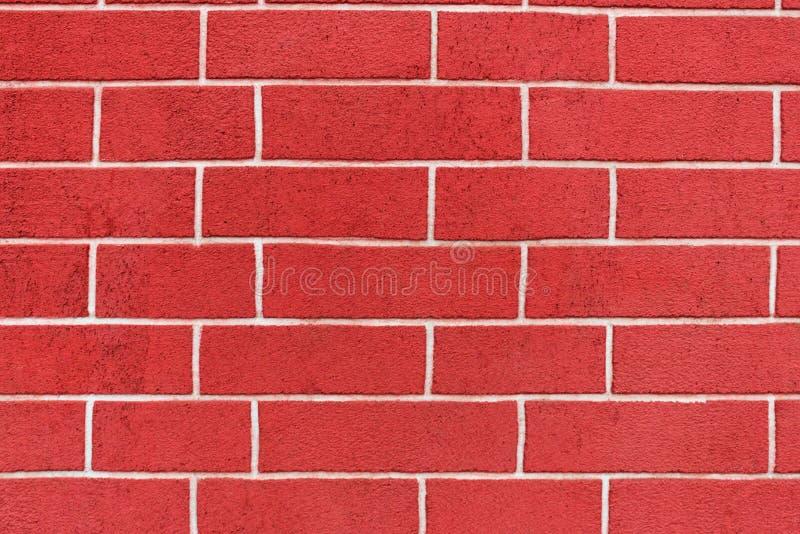 Fragment av en gammal fästningvägg för röd tegelsten som en bakgrund av den original- bakgrunden royaltyfri fotografi