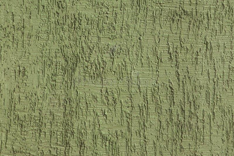Fragment av husv?ggen som t?ckas med texturerad murbruk Texturerad handgjord yttersida f?r gr?n f?rg f?r bakgrund arkivfoton