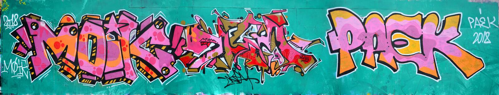 Fragment of a beautiful graffiti pattern in pink and green with. A black outline. Street art background image stock photos