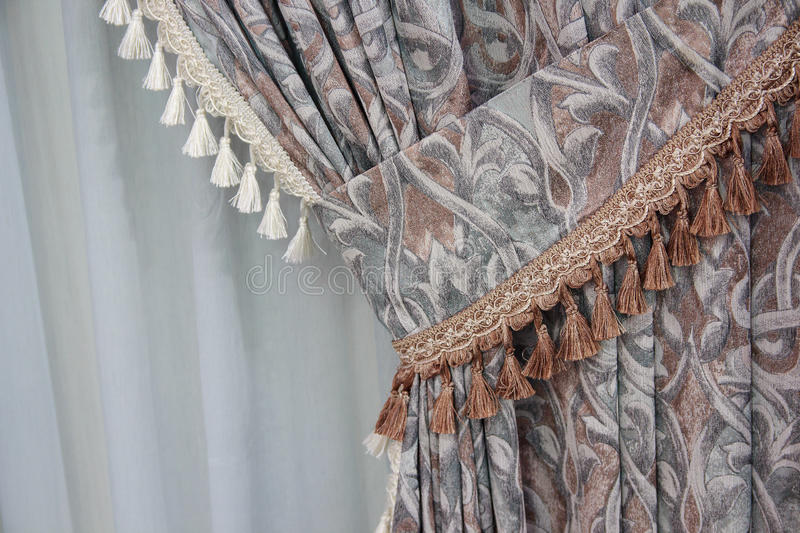 Fragment of the beautifully decorated curtains royalty free stock photos