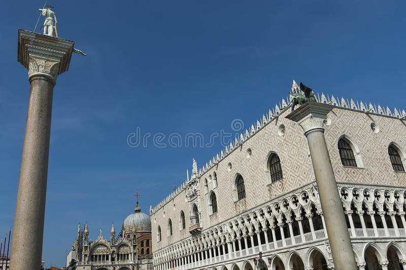 Fragment of beauty Saint Mark`s Basilica, Doge`s Palase and two columns with statue of lion of San Mark and of San Teodoro at Sa. N Marco square or piazza stock photography