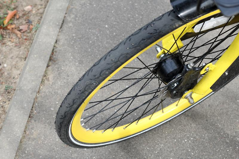 Fragment of a bicycle wheel. With a yellow rim. Disc brake visible stock photo