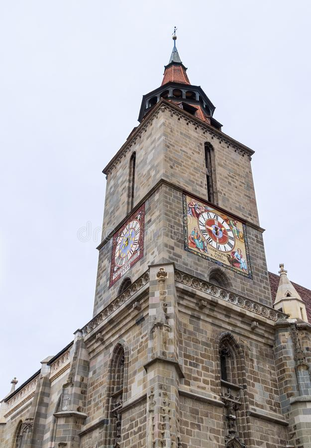 A fragment of the Black Church, built in the Gothic style and named after the dark color left after the fire of the 17th century i. N the Brasov city in Romania stock photography