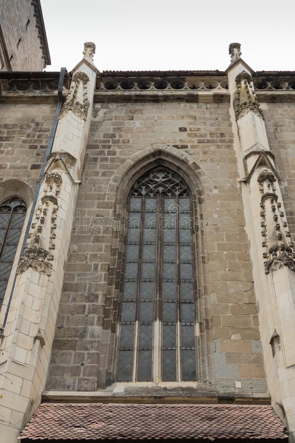 A fragment of the Black Church, built in the Gothic style and named after the dark color left after the fire of the 17th century i. N the Brasov city in Romania stock photo
