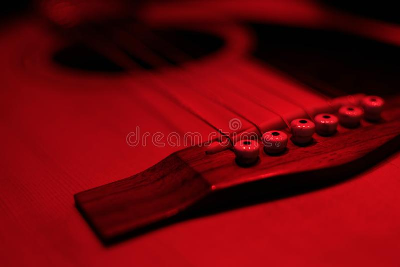 Fragment of the body of acoustic guitar royalty free stock photo