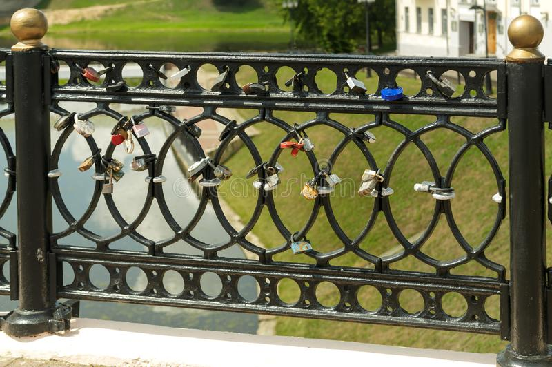 Fragment of a bridge over the river cast iron. royalty free stock photography