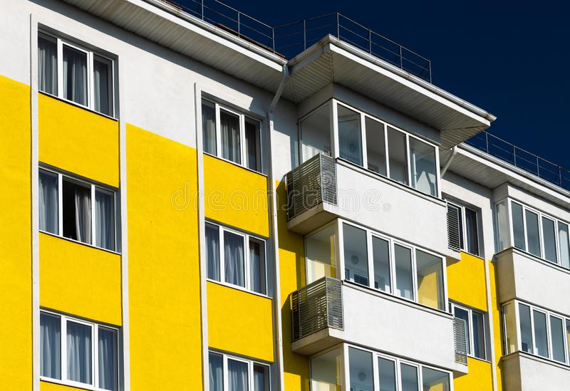 Fragment of brightly colored apartment building with balconies. Fragment of a brightly colored apartment building with balconies stock photo