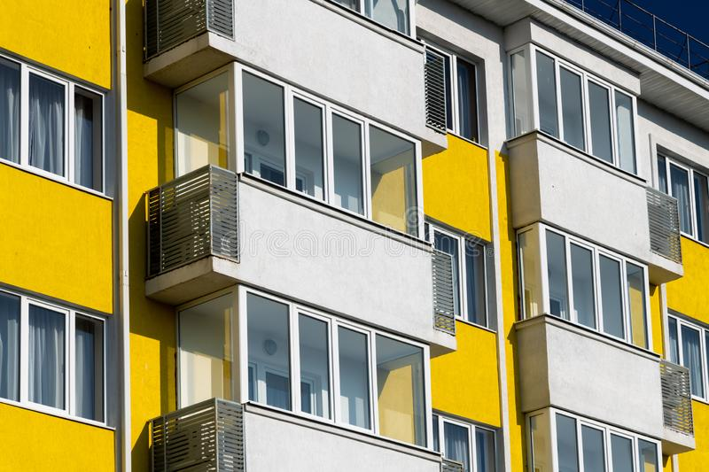 Fragment of brightly colored apartment building with balconies. Fragment of a brightly colored apartment building with balconies stock photography
