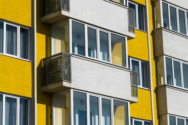 Fragment of brightly colored apartment building with balconies. Fragment of a brightly colored apartment building with balconies stock photos