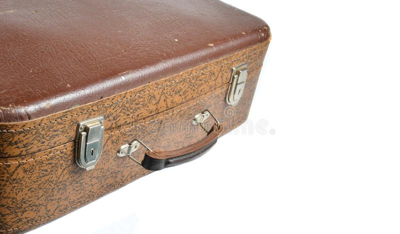 Fragment of a brown leather suitcase retro style isolated on a white background. Copy space. royalty free stock photography