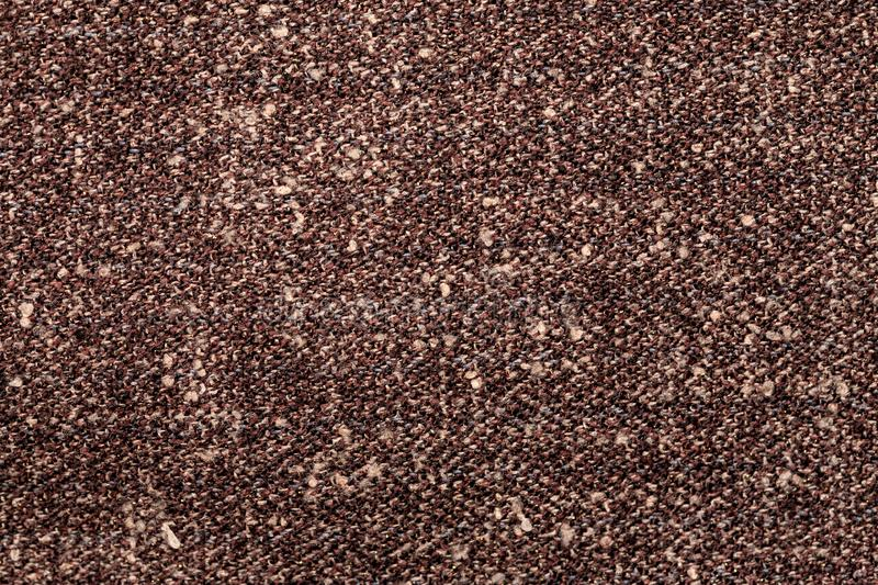 Fragment of brown piece of fabric, macro shot. Backdrop, background, burlap, cloth, cotton, material, rough, structure, surface, textile, texture, abstract stock photography