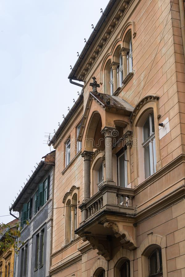 Fragment of the building with a decorative balcony on the Cetatii street. Sibiu city in Romania stock image