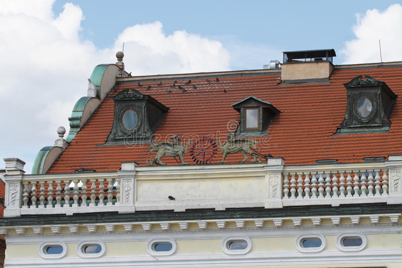 Fragment of a building in Prague with a parapet close up. Details stock photo