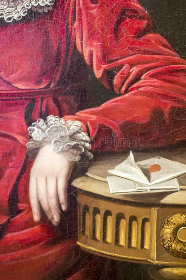 Fragment of the canvas `Portrait of Countess P. P. Kutaisova`, artist Jan Rombauer. Woman`s hand in a red dress. Female hand stock images