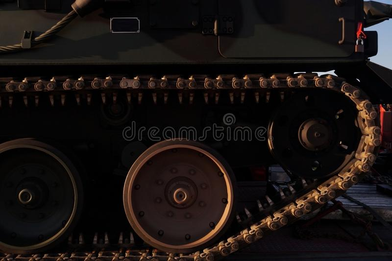 A fragment of a caterpillar military vehicle. View of caterpillar drive wheels. View of caterpillar drive wheels. A fragment of a caterpillar military vehicle royalty free stock image