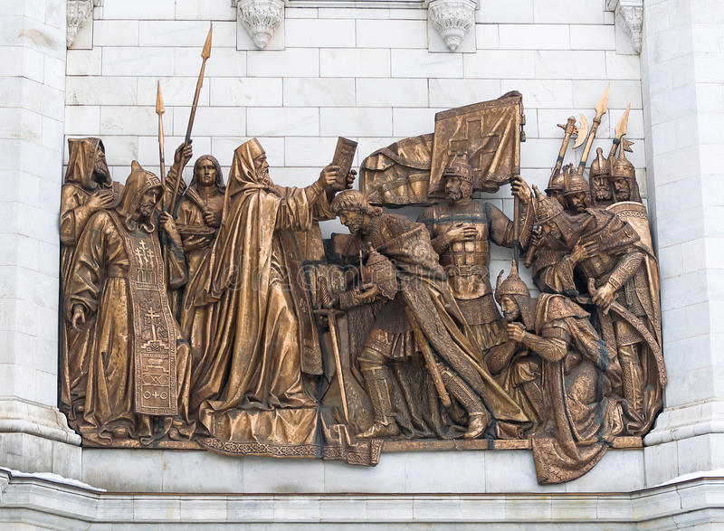 A fragment of the Cathedral of Christ the Savior. Bronze multi-figure composition 'St. Sergius blessing of Grand Prince Dmitry Do stock photos
